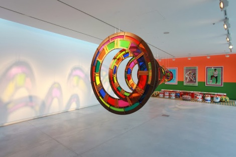 5. (front) Zak Ové, Time Tunnel, 2010, Perspex and plywood (back) Hassan Hajjaj, Le Salon, 2010, mixed media installation, installation view at Chaos into Clarity- Re-Possessing a Funktioning Utopia, image courtesy of Sharjah Art Foundation